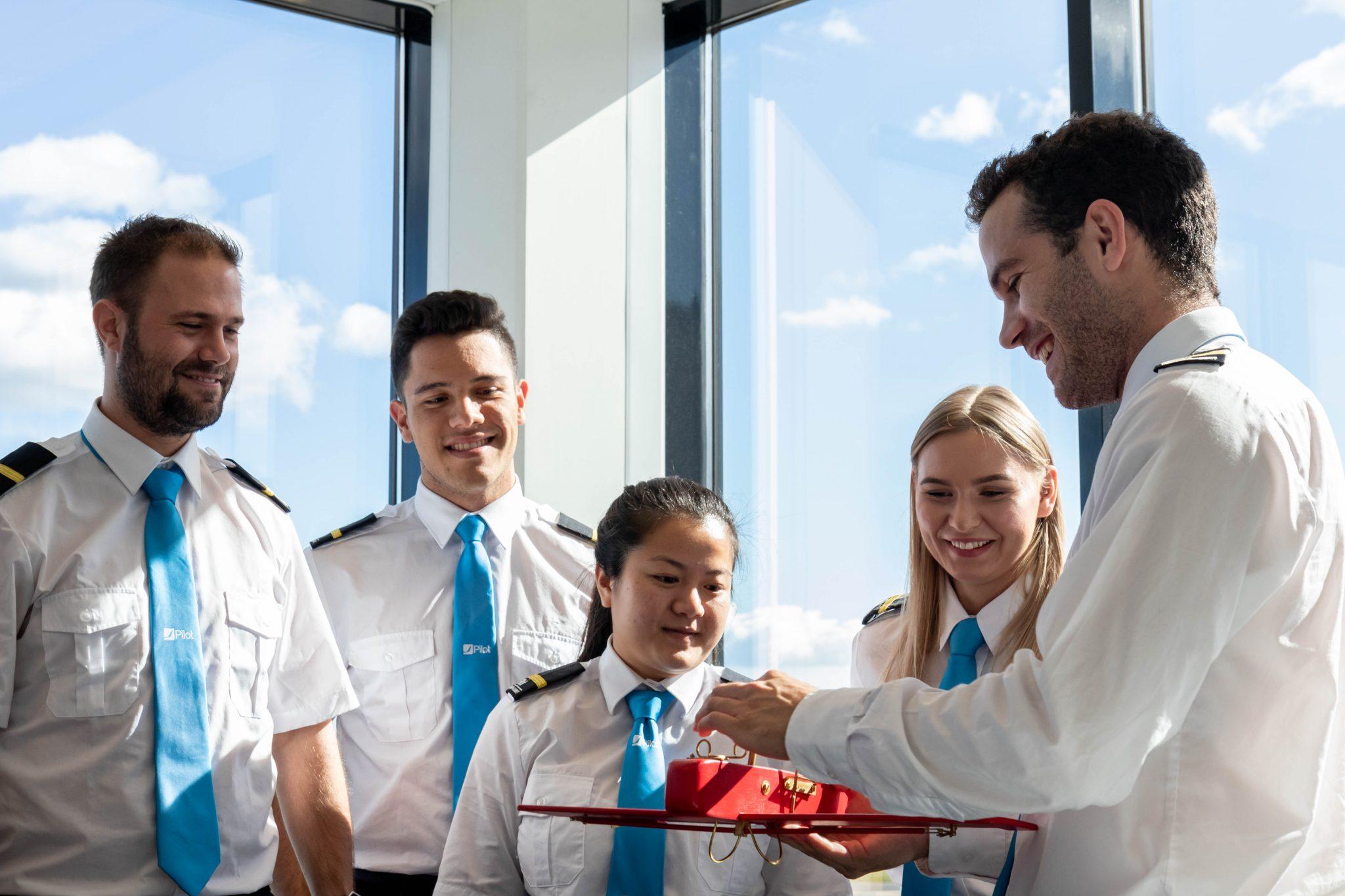 Flight instructor teaching students in briefingroom