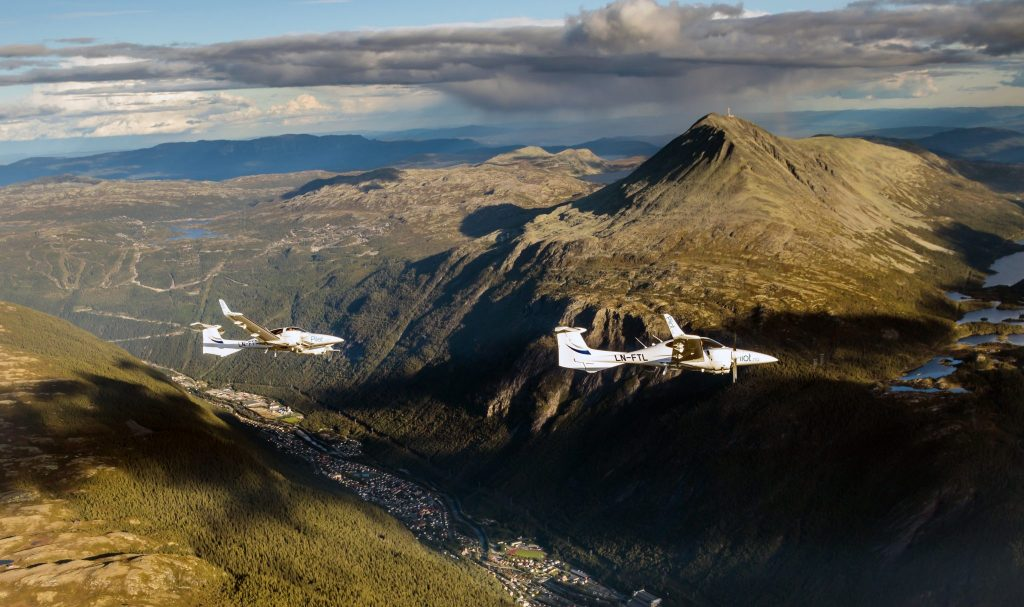 View of two DA42 flying over Rjukan. Gaustadtoppen is seen above Rjukan. Captured from a DA40
