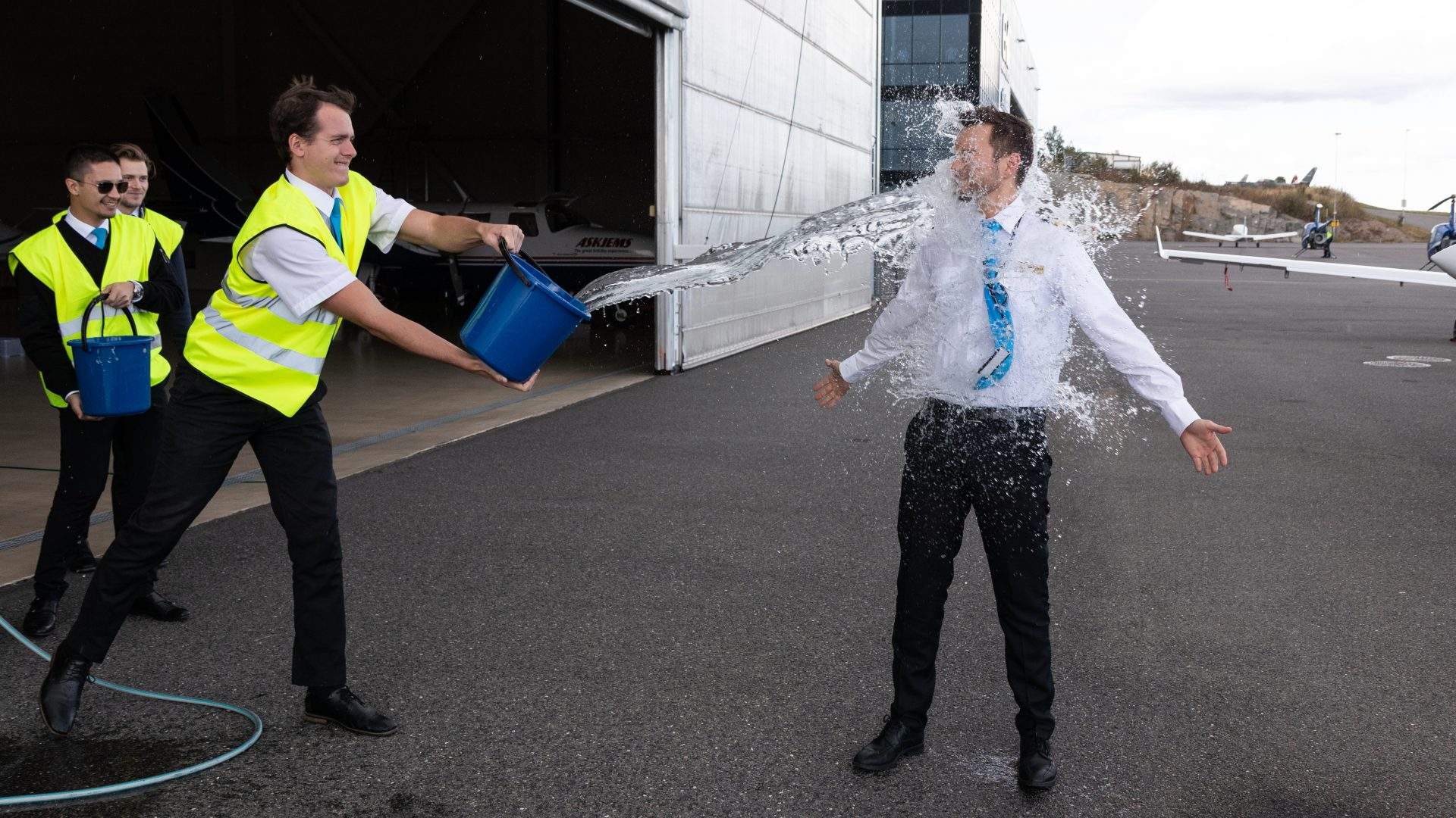 Student Hjerpsted is being baptized by his fellow students after his first solo flight