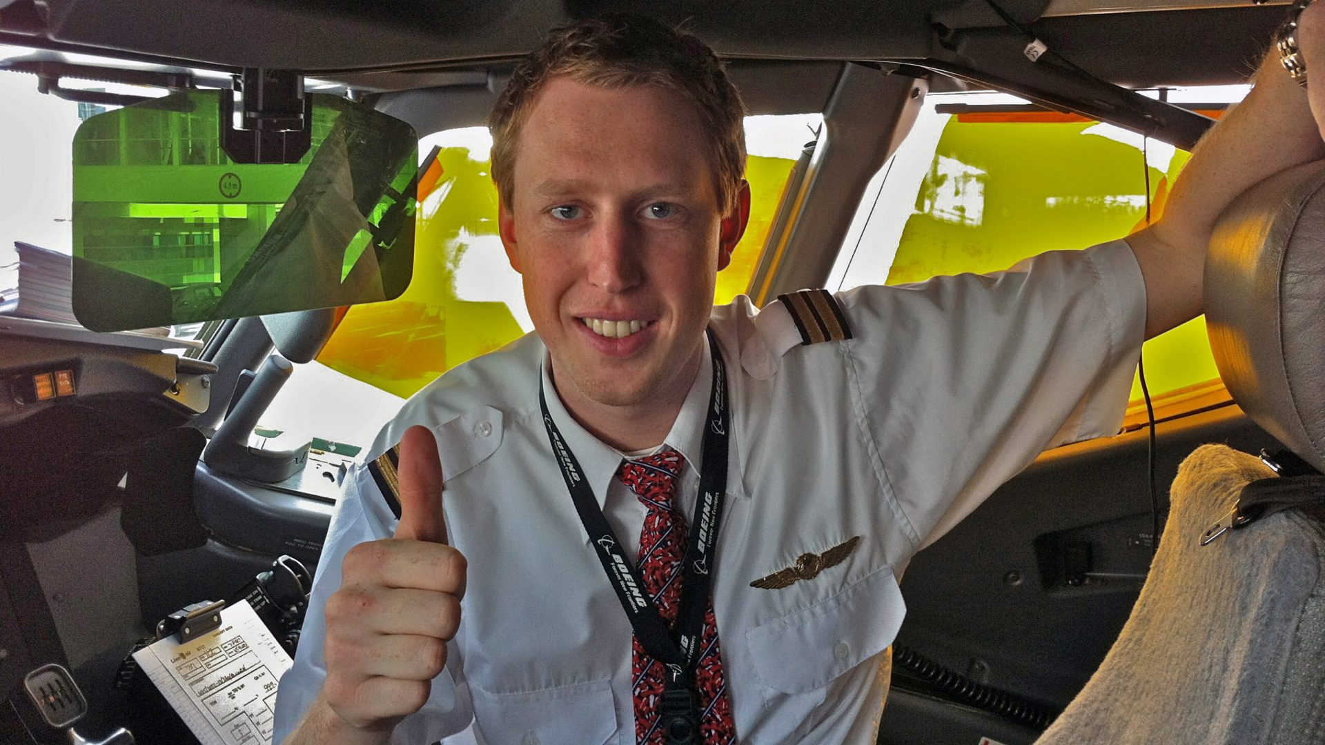 Pilot Mats Rove giving thumbs up from the cockpit