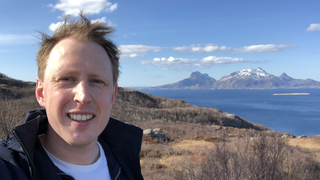 Mats Rove on a hiking trip in Molde with the ocean and mountains in the distance